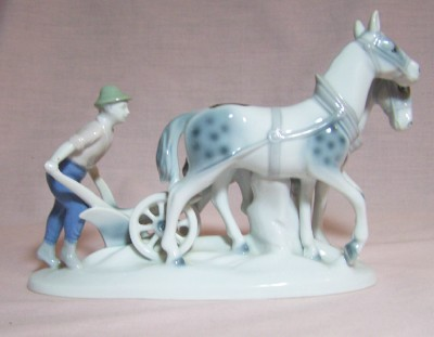 Farmer Plowing Figurine